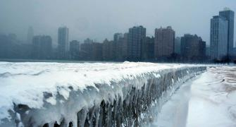 PHOTOS: Polar Vortex freezes US with snow