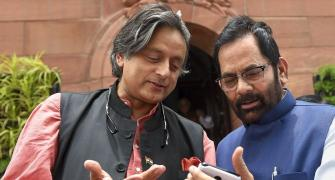 Caption this: What's Tharoor telling Naqvi?