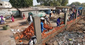 Ahmedabad builds Trump wall to keep slums out of sight