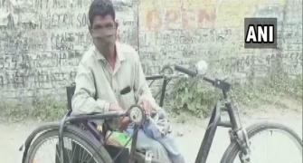 Differently-abled beggar distributes rations and masks