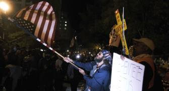 As US counts votes, protesters take to the streets
