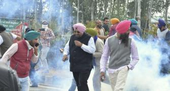Facing water canons, tear-gas, farmers push to Delhi