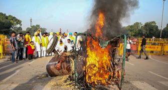 SEE: Cong workers set tractor afire at India Gate