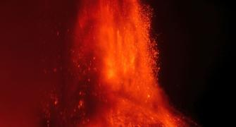 Mount Etna fills the sky with flame and lava