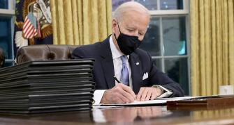 Biden signs order to end Trump's Muslim travel ban