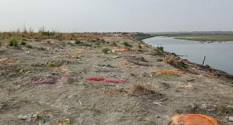 Now, bodies found buried in sand near Ganga