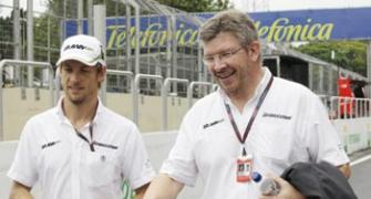 Your future is with us, Brawn tells Button