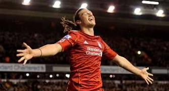 Carroll double helps Liverpool crush Man City