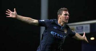 Deadly Edin Dzeko gives Man City precious victory