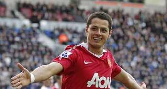 Hernandez double fires Man U four points clear