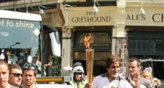 First Look: Big B carries Olympic flame in London