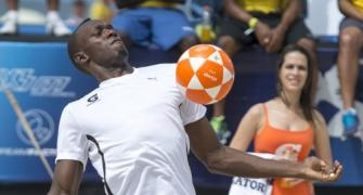 'Sprint King' Bolt signs for a football team