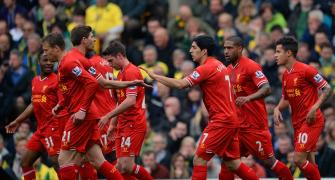 Football round-up: Liverpool, Atletico maintain title bids