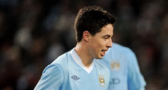 Man City's Samir Nasri out for eight weeks with knee injury