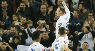 Euro qualifiers: Rooney scores in 100th match as England rally; Spain win