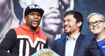 Pacquiao's trainer continues war of words