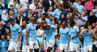 Man City flex muscles as English clubs break spending record