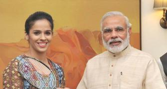 First Look: Saina presents her racquet to PM Modi