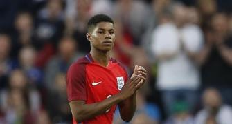 UK minister apologises for misnaming soccer star