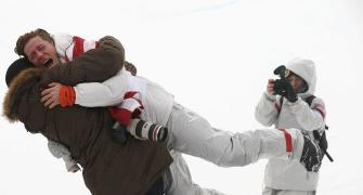 Winter OIympics PIX: US snowboarder White stamps legacy with third gold