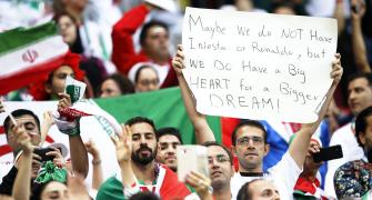 PHOTOS: The World Cup dream goes on for Iran despite Spain defeat