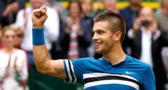 Federer loses No 1 spot as Coric stuns him in Halle final