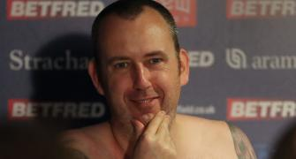 WATCH! This champ strips naked for his winning press conference