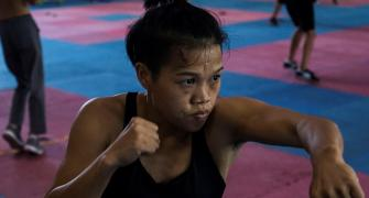 Boxer beats stereotypes to become 'Queen of the Ring'