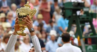Djokovic outlasts Federer to win fifth Wimbledon title