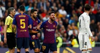 Barca hailed as champions-elect after beating Madrid