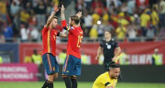Euro qualifiers: Scrappy wins for Spain, Italy