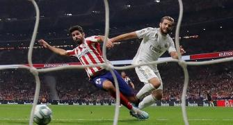 Real Madrid top La Liga after derby draw at Atletico