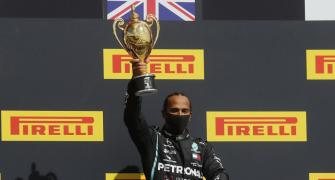 F1 PIX: Hamilton wins British GP with punctured tyre
