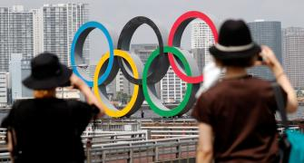 Japan sponsors shelve ads as mood sours over Olympics