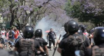 PHOTOS: Riot breaks out at Maradona's funeral