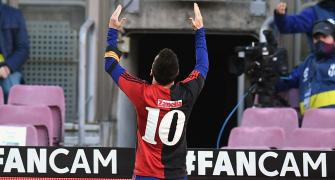 Messi salutes Maradona as Barca trounce Osasuna
