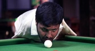 PIX: Born without arms, Pakistani man masters snooker