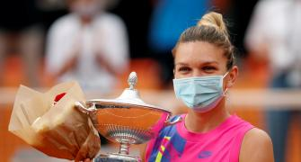 Halep claims Rome title after Pliskova retires