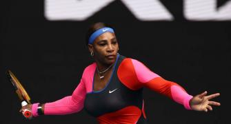 Serena channels Olympic champ FloJo with catty outfit