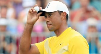 Recovering Tiger Woods in 'good spirits'