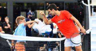 Out then in, Djokovic plays a set in Adelaide