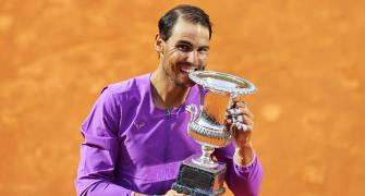 Nadal overcomes blip to down Djokovic in final