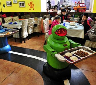 IMAGES: A restaurant where robots cook and serve food