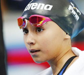 Only 10, she is the youngest ever at the World Swimming Cships!