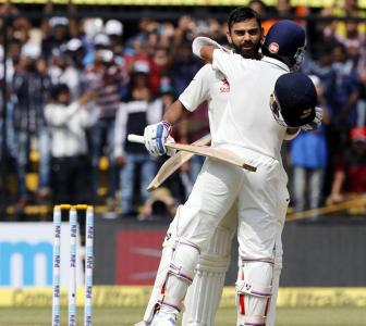 Kohli's 211 and Rahane's 188 propels India to a huge total