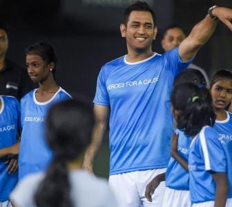 PIX: Dhoni takes to the football field