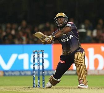 PICS: Russell's late blitz fires KKR past RCB