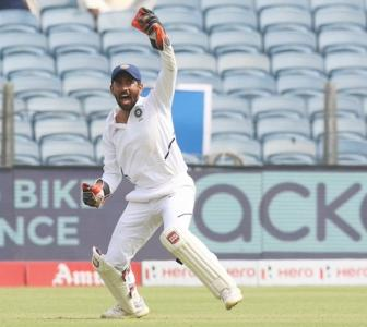 Here's why Umesh owes Saha a treat...