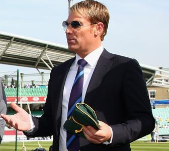 Warne auctioning 'baggy green' to raise funds