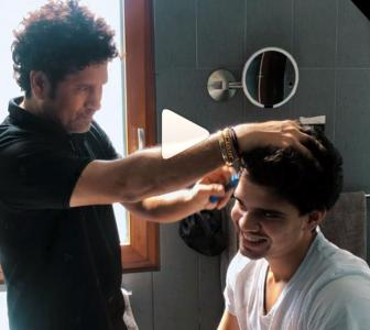 SEE: Sachin gives son Arjun a haircut